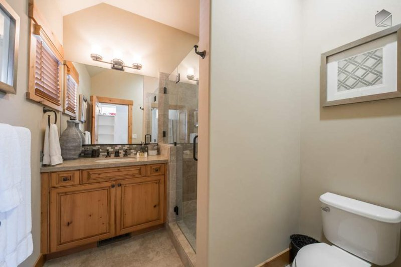 The bunk room's attached ensuite bathroom has its own walk-in shower.