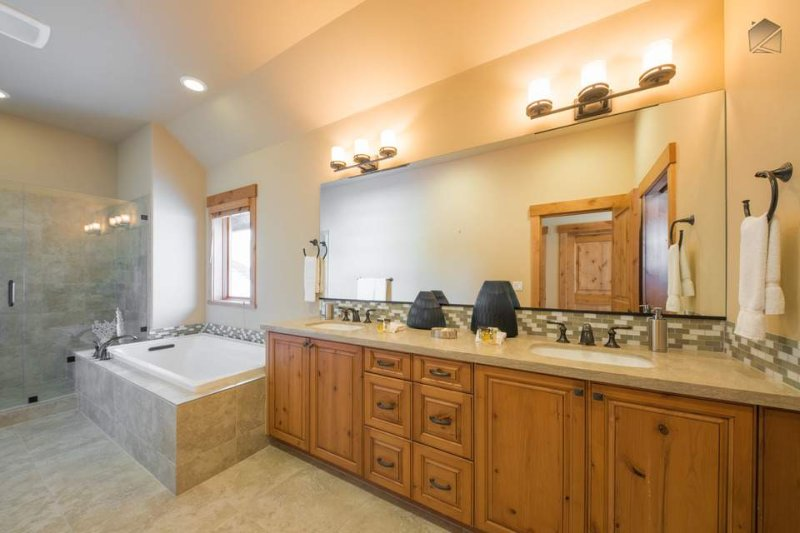 The large Master Bathroom has a walk-in shower and a deep soaking tub.