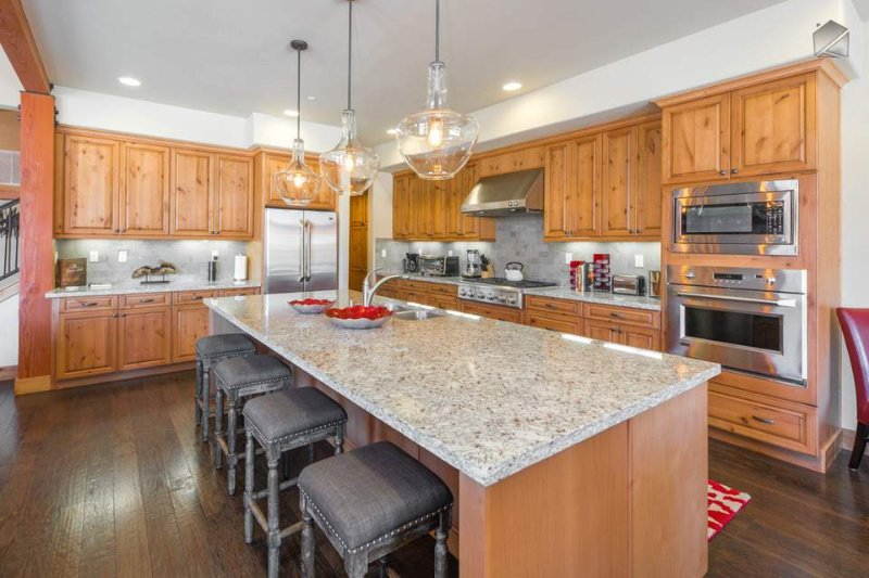 Granite counter tops rim the kitchen, and stainless steel appliances add a touch of modernity.
