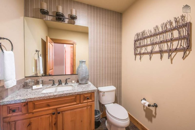 A convenient powder room on the first floor has a subtly rustic decor.