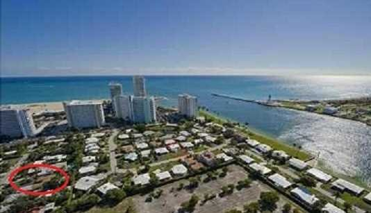 The home is located next to the Port Everglades main channel.