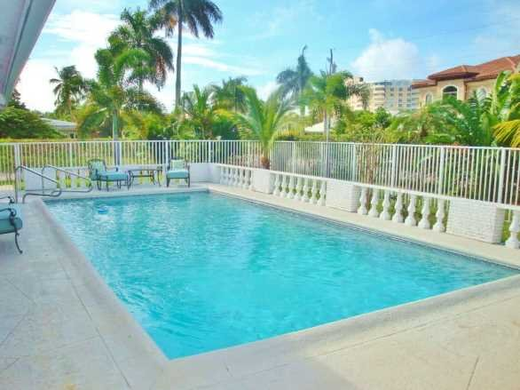 Enjoy the South Florida lifestyle, sunny blue skies and warm breezes poolside.