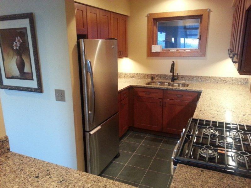 New upscale kitchen with cherry, slate, quartz