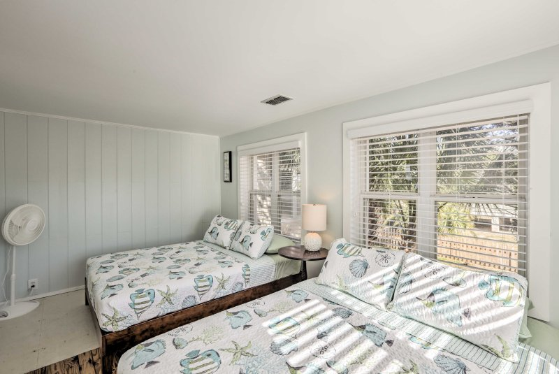 This first bedroom houses 2 queen-sized mattresses.