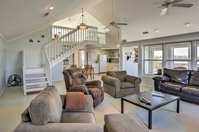 Vaulted ceilings create an open and airy atmosphere throughout the main level.