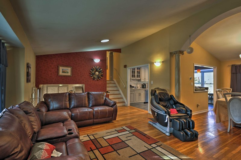 A larger living space also features soft leather furnishings with enough seating for everyone.
