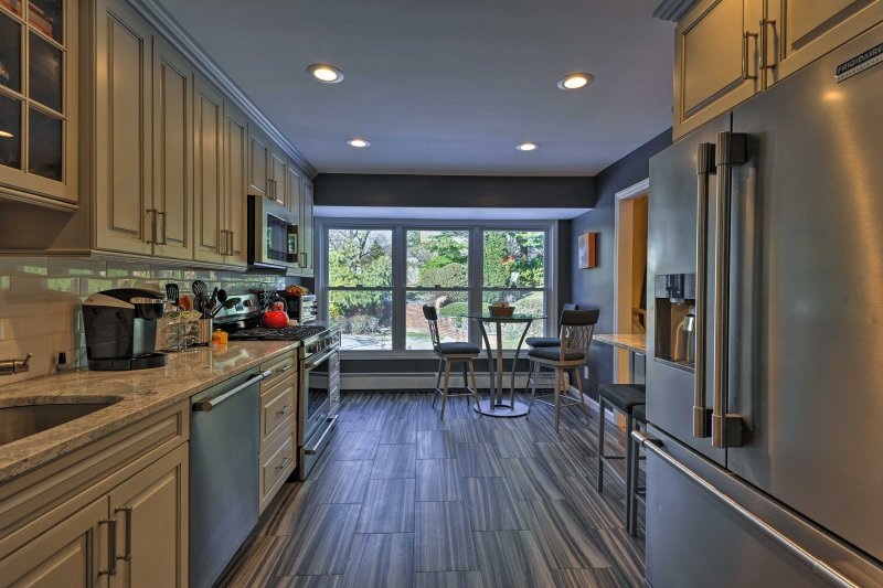 The stainless steel appliances and quartz countertops polish off this space!