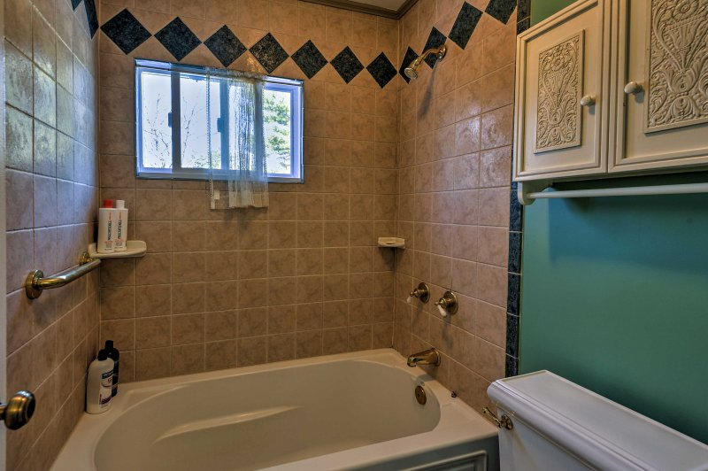 Enjoy a long soak in the built-in tub.