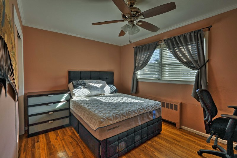 A premier queen Tempur-pedic mattress is featured in this third bedroom.