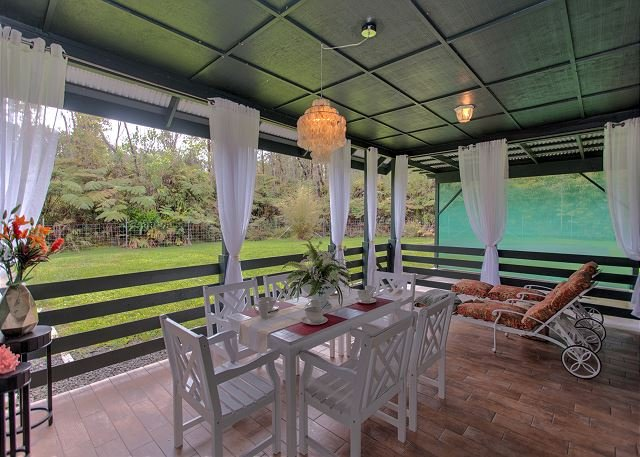 Lanai with Formal Outdoor Dining and Lounge Chairs.