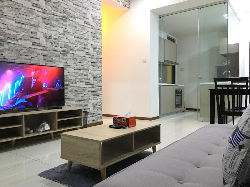 living area with aircon and ceiling fan, 49' TV