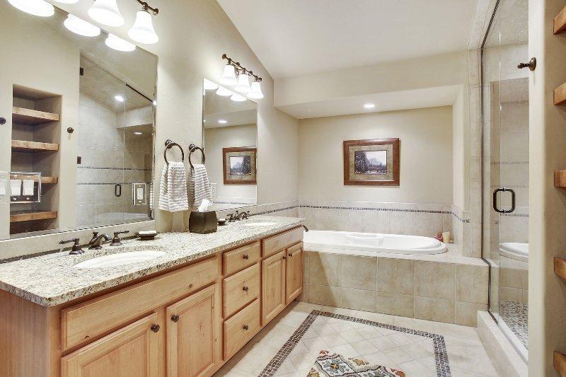 Large master bath suite with custom stone