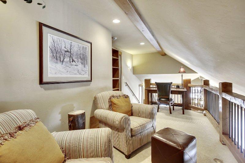 Upper loft sitting area with desk
