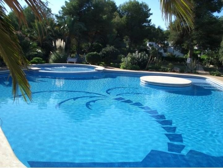 Beautiful communal pool and children's pool, steps and island. Pool area is just by back garden gate