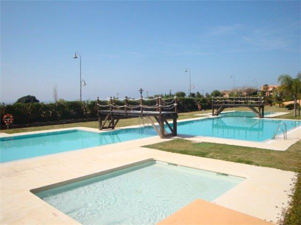 The community pool with childrens pool next to the beach