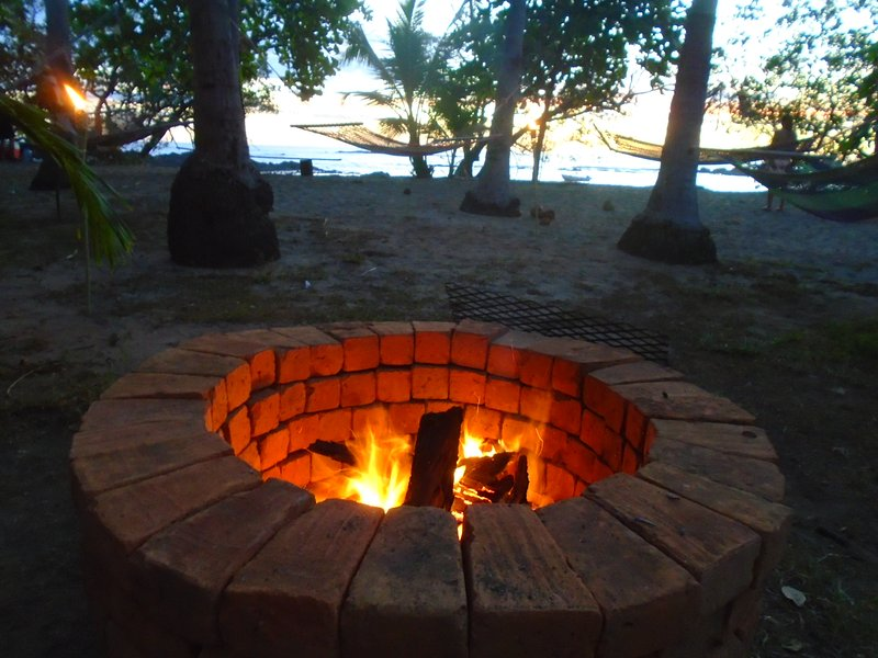 relax & enjoy a evening fire on your Tropical Beach in front of your #3 Cabina under starlit sky