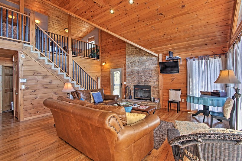 Watch the flat-screen cable TV as the fireplace warms the room.