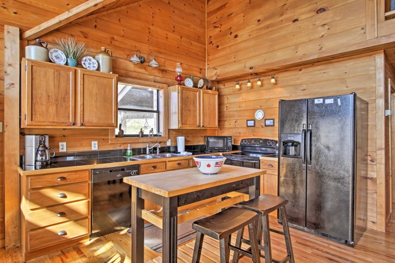 The kitchen is fully equipped with modern appliances.