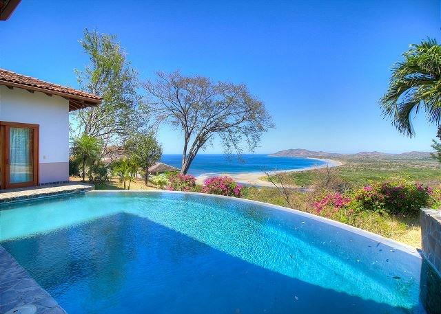 Infinity pool and panoramic view of Tamarindo Bay