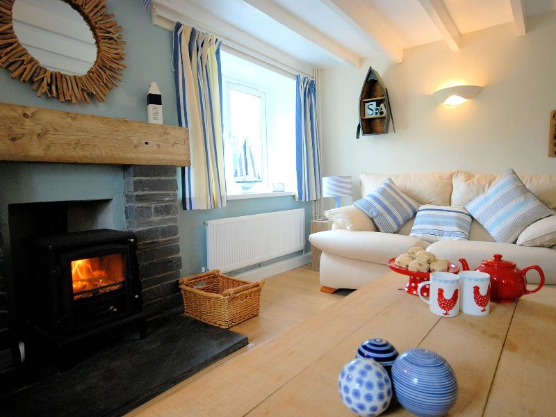 Relax with a cup of tea in front of the warming wood burner