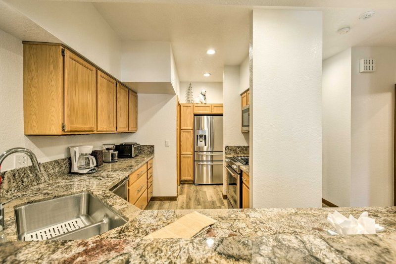 The kitchen is fully equipped with new appliances, countertops and cabinetry.