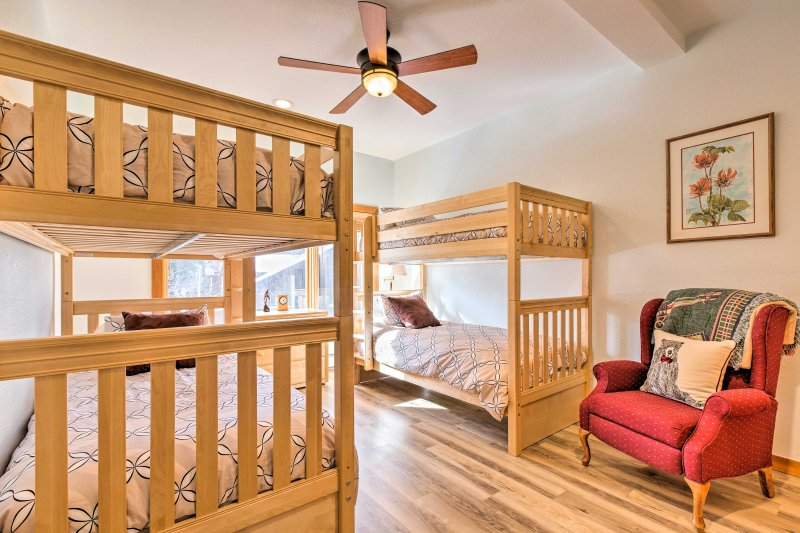 Kids can make their home base in this room with 2 twin-over-twin bunk beds.