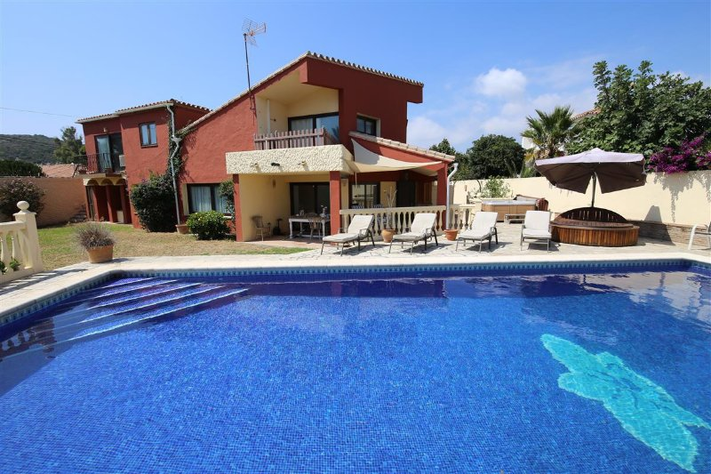 Swimming pool with villa to rear