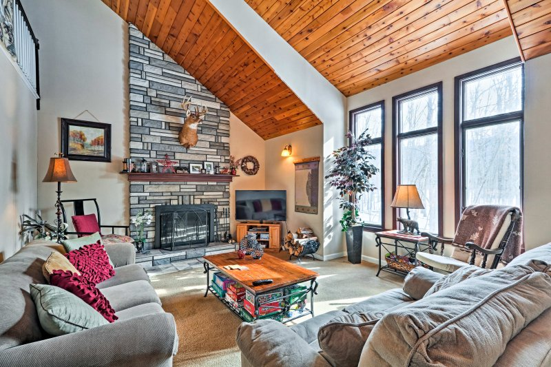 The wood burning fireplace and floor-to-ceiling stone chimney make for a cozy setting that's perfect for winter.