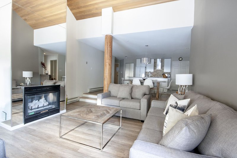 Open plan living room featuring a gas fireplace to cozy up to in the winter months