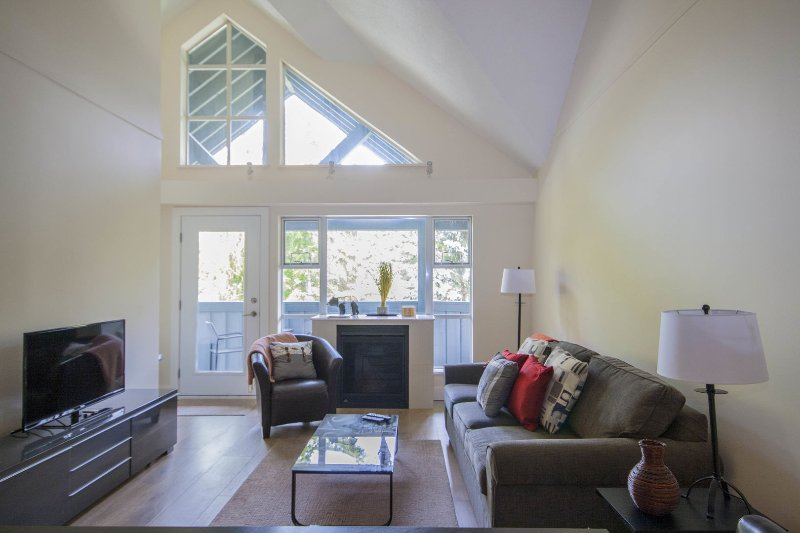 Open concept living and dining area with vaulted ceilings for a spacious feel