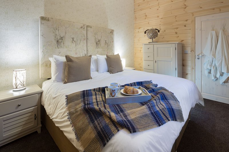 Supersized Double beds plus solid pine log cabins, peace & tranquillity, equal a great nights sleep
