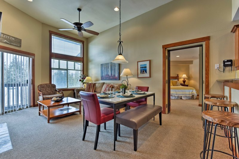Large windows flood the great room with natural light.