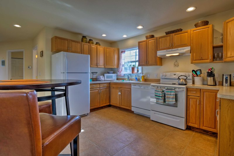 Cook up a feast in the fully equipped kitchen!