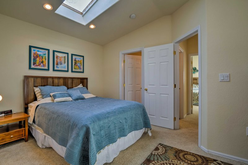 Retreat to the comfort of the master bedroom furnished with a queen bed.