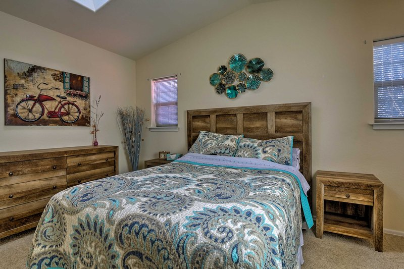 Additional guests will sleep soundly in the second bedroom with a queen bed.