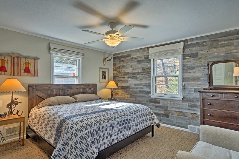 Drift off to dreamland in this open and airy master bedroom with a king bed and fashionable decor.