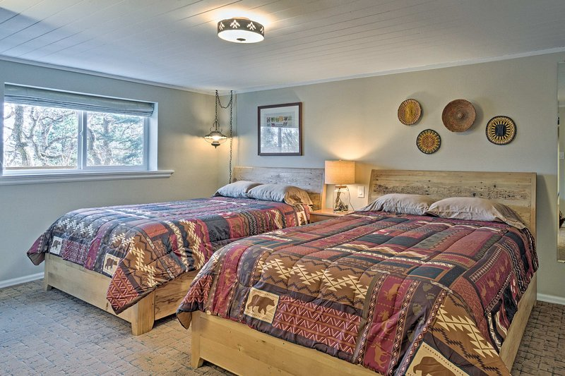 The fourth bedroom offers 2  queen beds and an abundance of natural light.