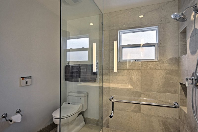 Rise and shine with a refreshing shower in this full bathroom.