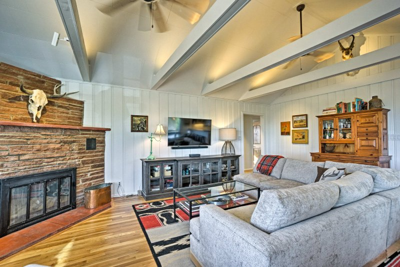 You'll love unwinding in this serene space with a wood-burning fireplace and flat-screen cable Smart TV,