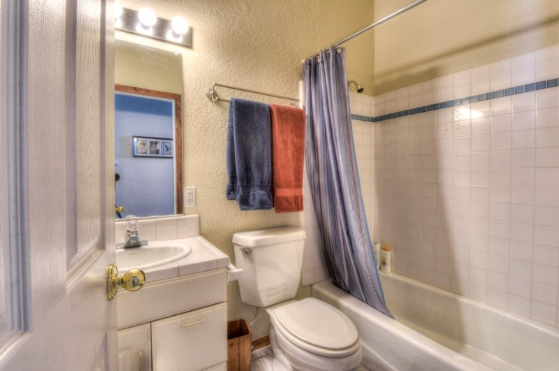Third bathroom with tub and shower
