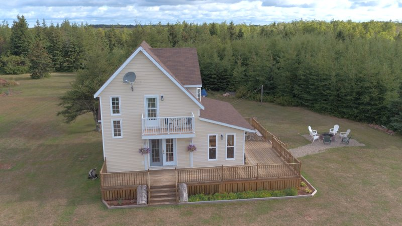 Your home away from home!  Set on a quiet acre, just one lot from beautiful Malpeque Bay!