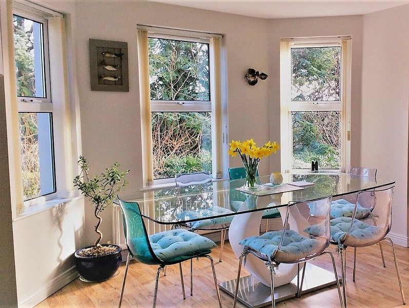 Dining table overlooks the garden area.
