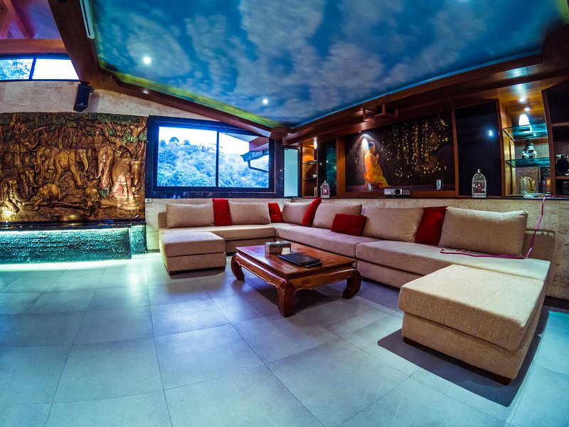 Lounge area with projector and home Theatre system