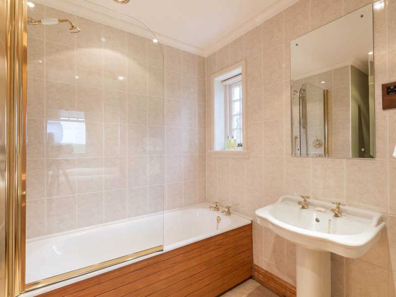 Second bedroom ensuite with shower and full sized bath