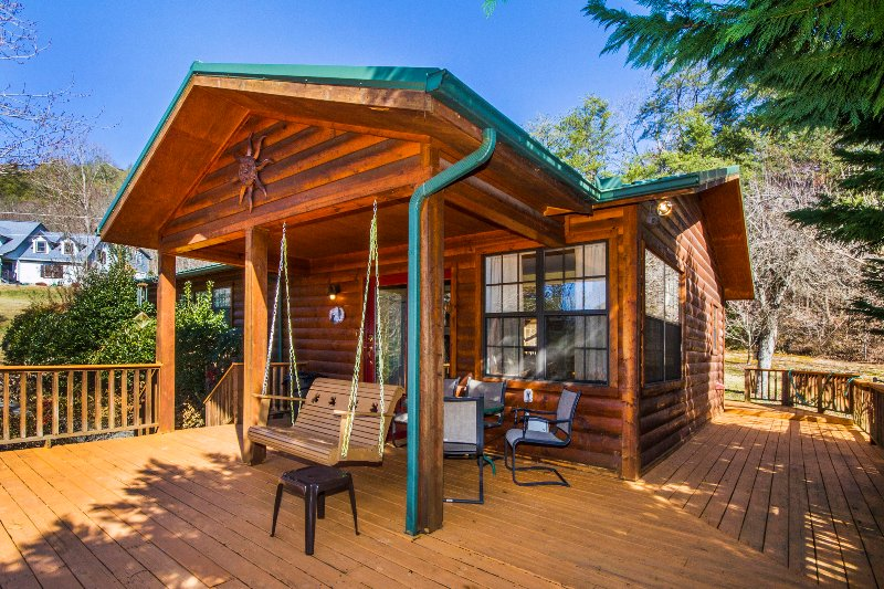 Swing on the large front deck overlooking gardens and views