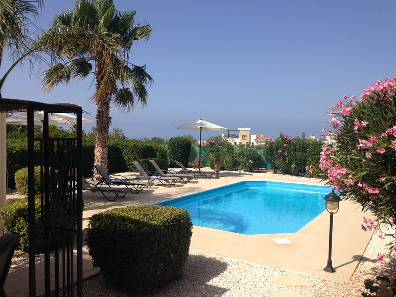 View across the garden and pool down towards the sea