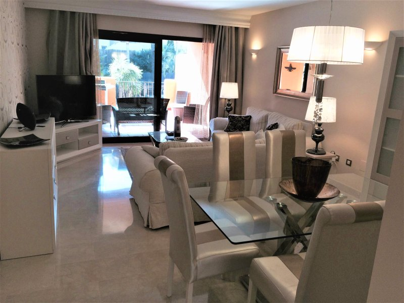 Lovely comfortable apartment. Lounge & dining area with patio doors to terrace