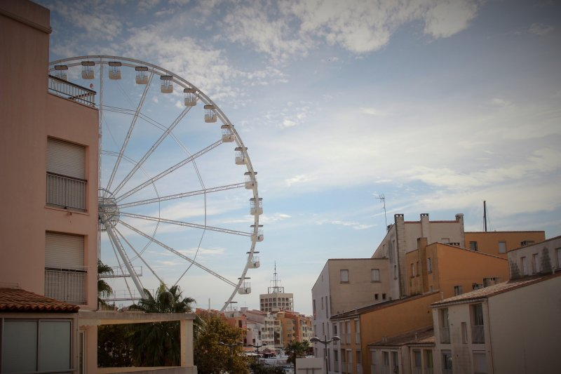 Enjoy a terrace overlooking the Ferris wheel, in the central port