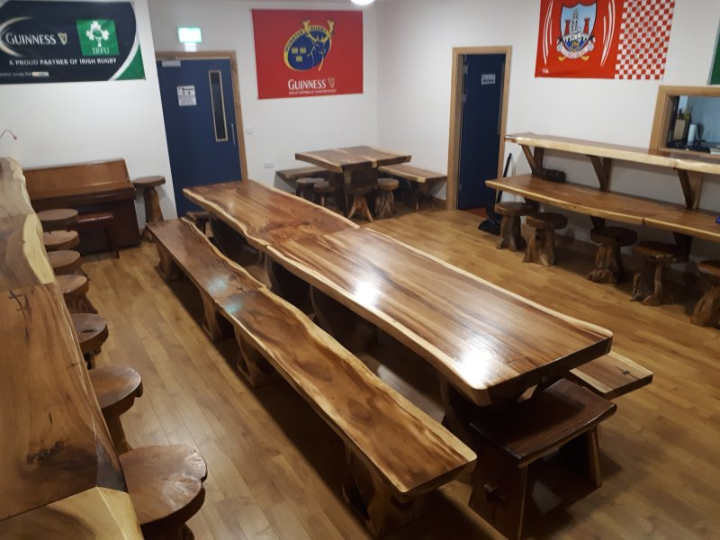 Dining room with lots of hardwood tables and seats