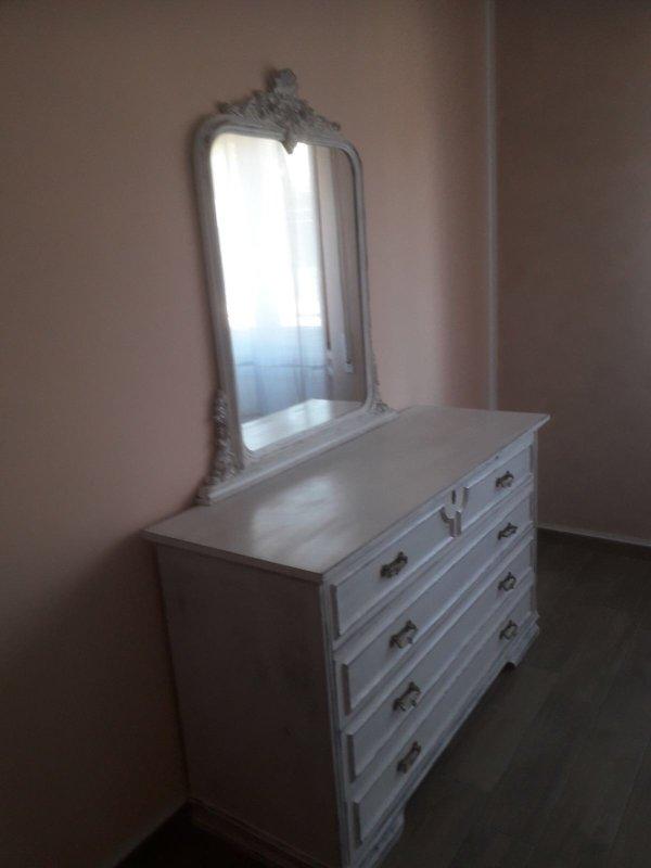 Dresser with mirror in the bedroom.